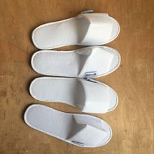 Yangzhou nuoxing spot sale white towel category no logo hotel <strong>slippers</strong> manufacturers
