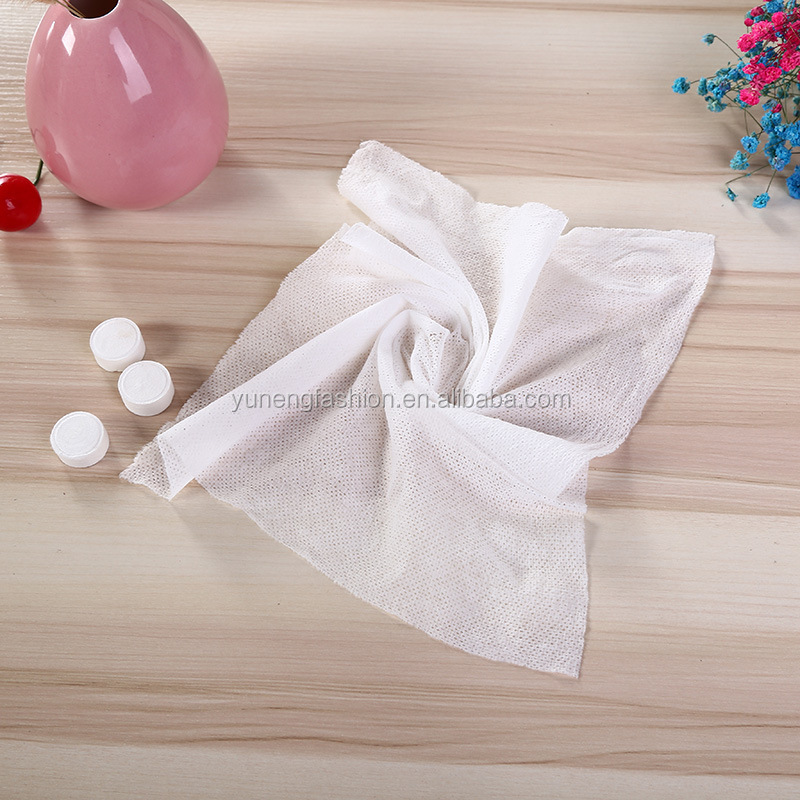 china factory sale 10pcs tube packing 100%rayon rectangle compressed magic tissue/towel/wipes and nonwoven technics