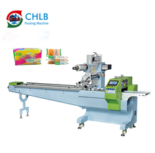 Disposable soap flow packing machine price automatic fabric roll tableware packing machine sponge spoons packing <strong>equipment</strong>