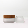 /product-detail/empty-30g-50g-100g-round-glass-jar-cosmetic-packaging-bamboo-with-wooden-top-62368008544.html