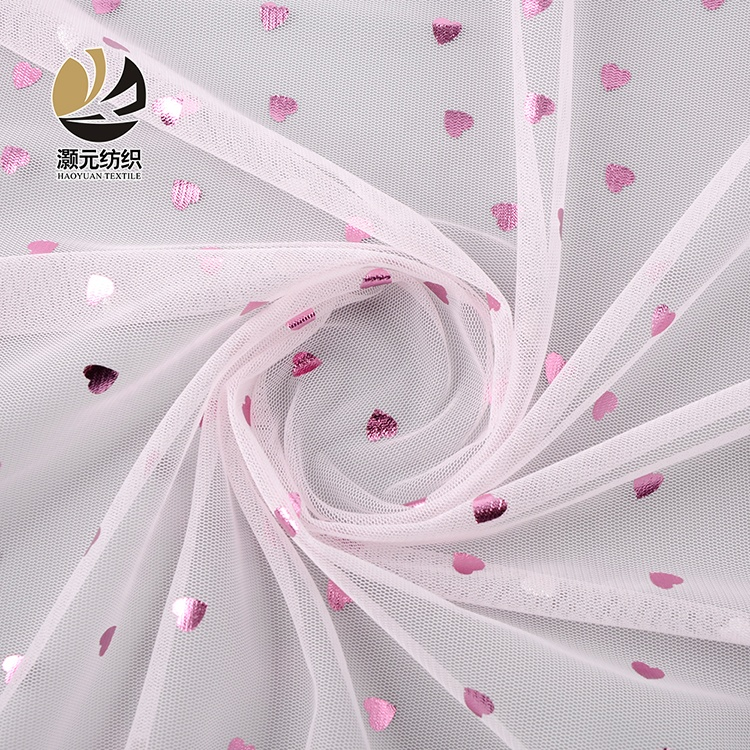 Hot sale high quality nice design printed pink heart patterned tulle mesh fabric for wedding dress