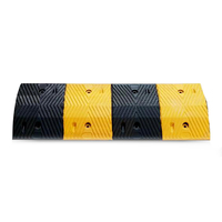Road traffic yellow and black cast steel and rubber speed bumps