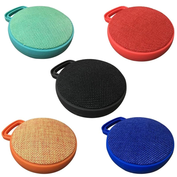 <strong>Q10</strong> Portable Fabric Music Mini Wireless Outdoor Cloth Speaker Professional Sport Round Bluetooths Speaker With Plastic Button