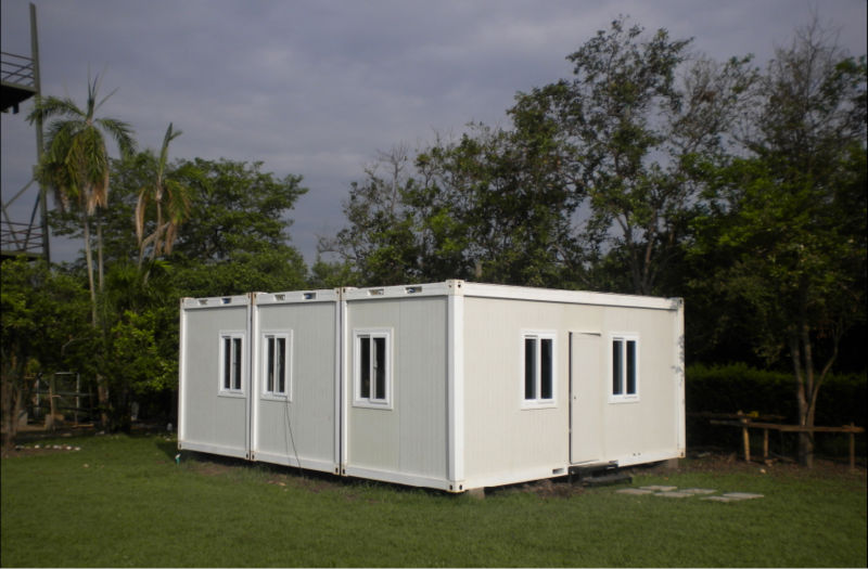 Low cost flat pack foldable container houses
