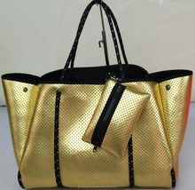 perforated metallic neoprene hand bag perforated bag