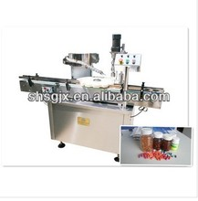 Automatic bottle Capper machine for round bottles, put the cap on the plastic