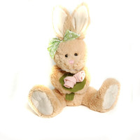 Holding the flower plush cute toy rabbit with kids