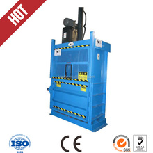Hydraulic vertical lifting door baler for compressing waste paper
