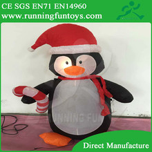Christmas inflatable party animated lights up penguin in hat & carry candy cane decorations