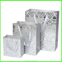 Customized Size Silver Stamping Shopper Packing Ivory Board Paper Bag