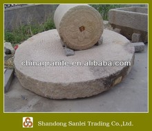 antique granite grinding millstone