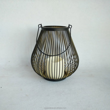 Small birdcage style metal wire candle holder