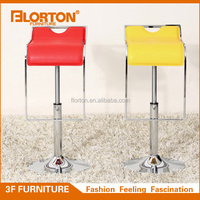 Adjustable yellow leather bar stool