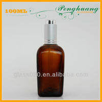 essential oil amber glass bottles with silver press pump 100ml made in guangzhou