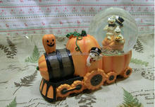 Custom creative pumpkin train with skull design polyresin snow globe for decoration