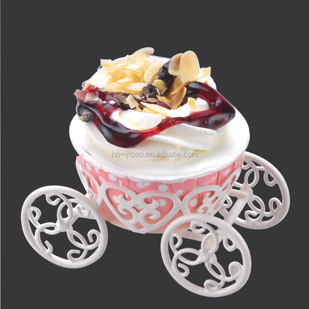 white cinderella carriage cake stand with single cup design