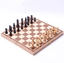 folding chess board game with wooden chess pieces