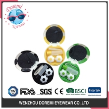 Soccer style contact lens cases with spray lens bottle and tweezers