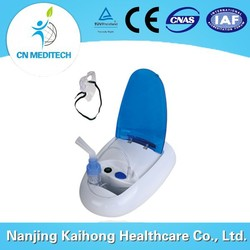 Portable quiet compressor for nebulizer for home and clinic use