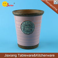 Small pink glazed terracotta flower pot