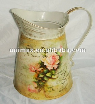 Rustic metal decorative water pitcher