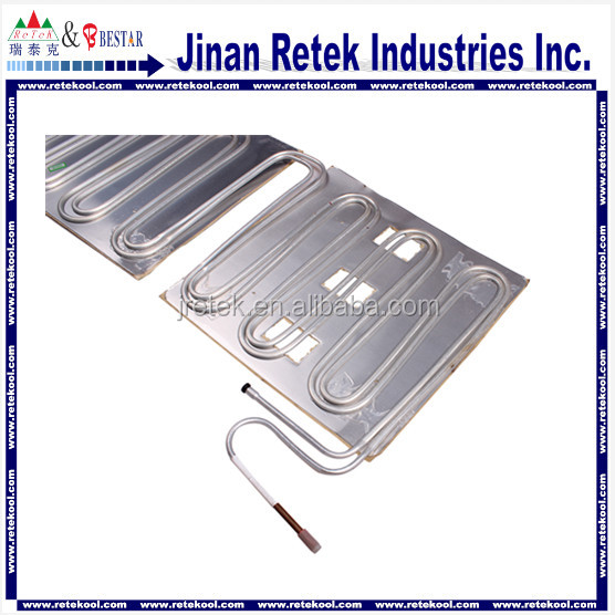 Plate tube cooler evaporator for refrigerator heat exchange