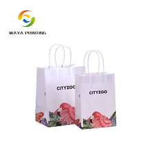 Machine made white kraft paper gift bags wholesale