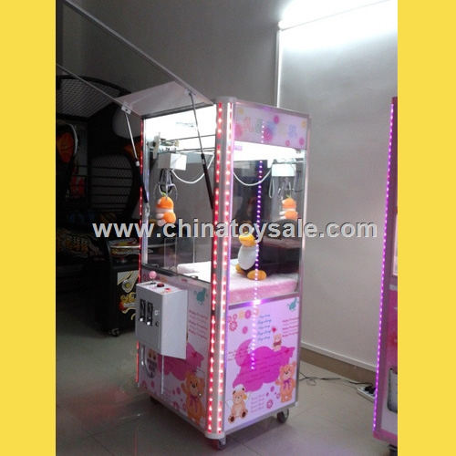 Best selling coin operated claw crane machine / toy vending machine / doll grabbing machine
