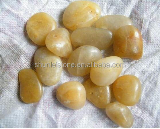 Yellow polished natural river pebbles for sidewalk paving