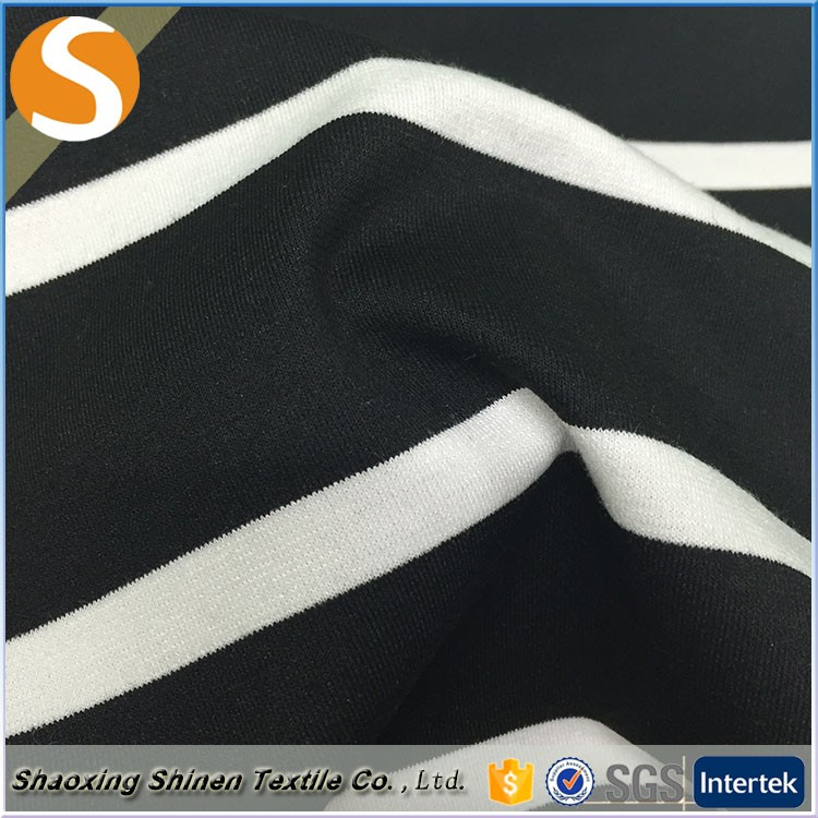 Shipping stretch black and white stripe ponti roma fabric