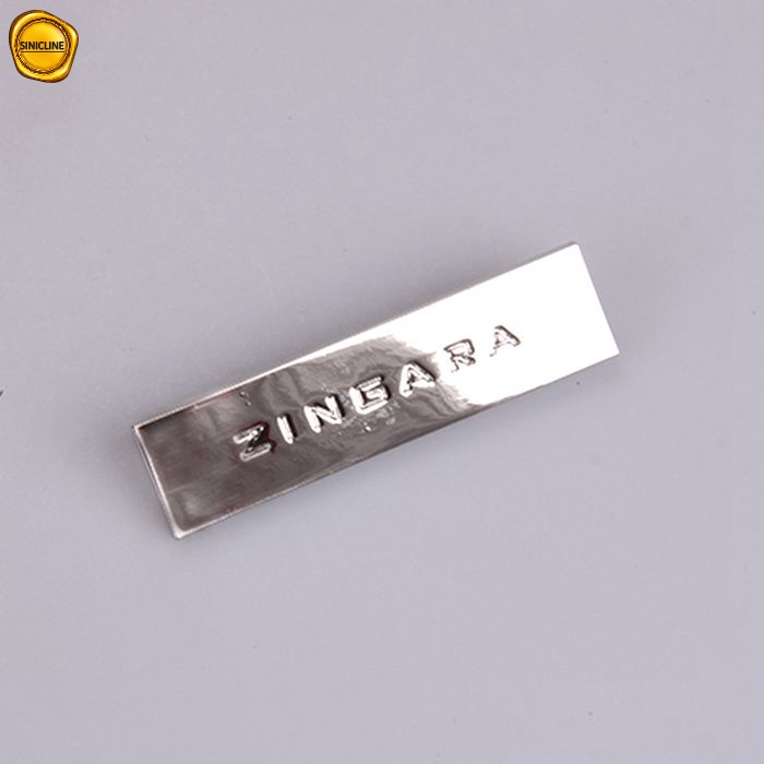 Sinicline shiny silver brand name debossed customized metal logo for handbags