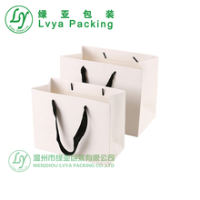 Art paper Promotional CHEAP newspaper bags wholesale