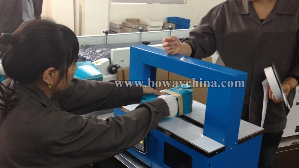 Desktop Automatic OPP and Paper Tape strapping banding machine