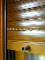Manual rolling vertical window shutters
