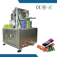Semi-automatic adjustable folding box gluing machine