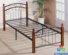 Strong matte black finish metal bed frame with wood posts and mattress support