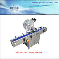 automatic label attaching machine