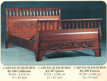 Carved sleigh bed