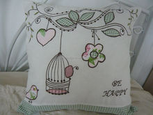 cut bird embroidery and applique cushion