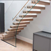 Modern residential custom wooden stairway with glass railing