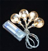 led glass and string light with printed snowflake as christmas decor