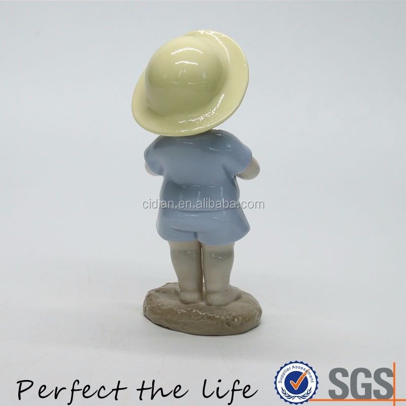 Ceramic Standing porcelain figurine with hat and telescope