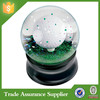 Polyresin snow ball souvenir with golf
