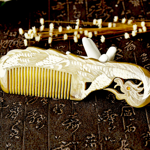 The elegant Dragon and Phoenix yak horn comb