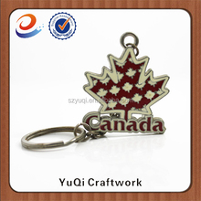 Cheap price have stock Canada souvenir leaf metal keychain with rhinestone