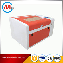 low cost 50w plastic laser cutting engraving machine for cake topper