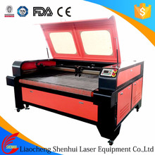 Professional auto feeding fabric textile leather fletmat laser cutting machine for sale