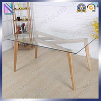 tempered glass dining table top with wood pattern motif solid wood legs base