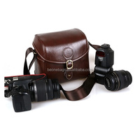dark brown trendy leather dslr camera bag with shoulder belt