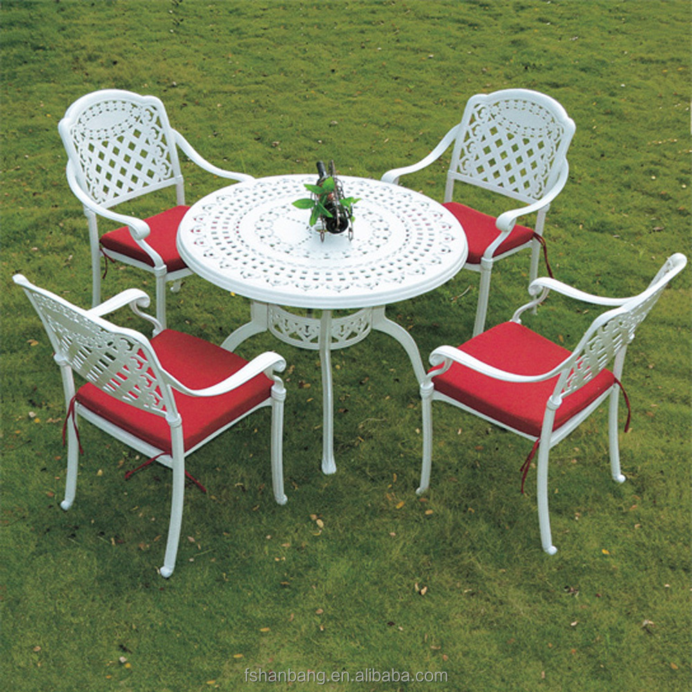 Cheap white wrought cast iron outdoor table and chair for Best buy patio furniture